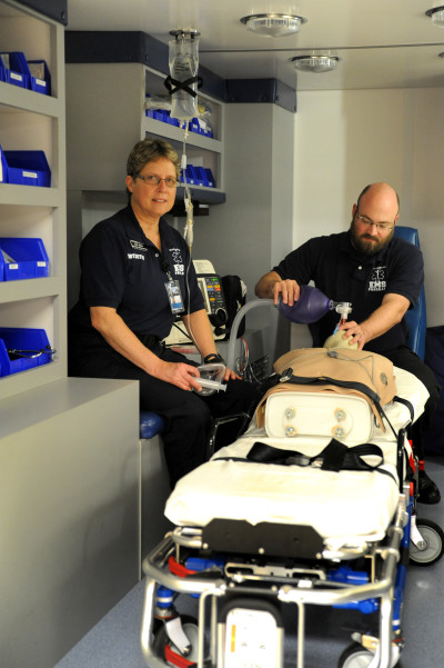 Victoria College Paramedic Coordinator Susie Jechow, left, and EMT-Paramedic student Billy Jordan practice life-saving procedures in a classroom ambulance.
